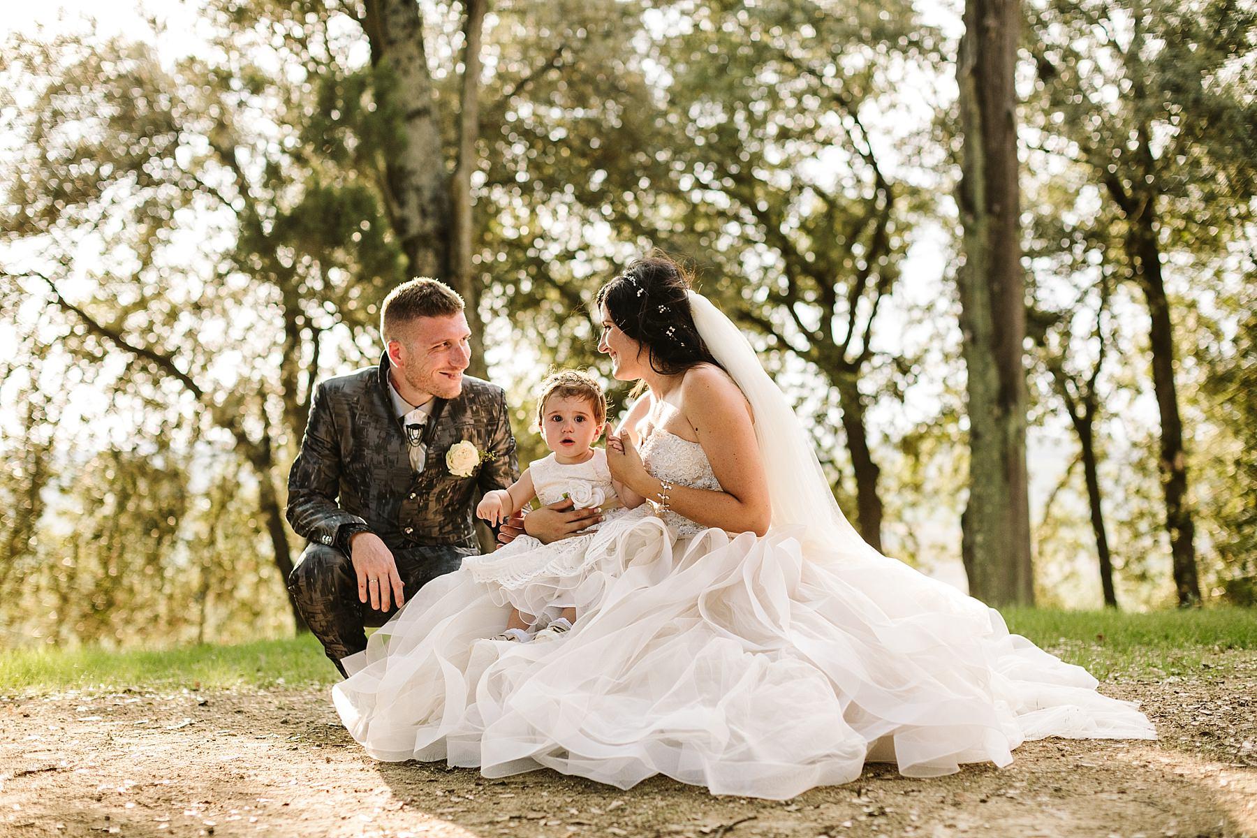 coppia di sposi con la loro bambina