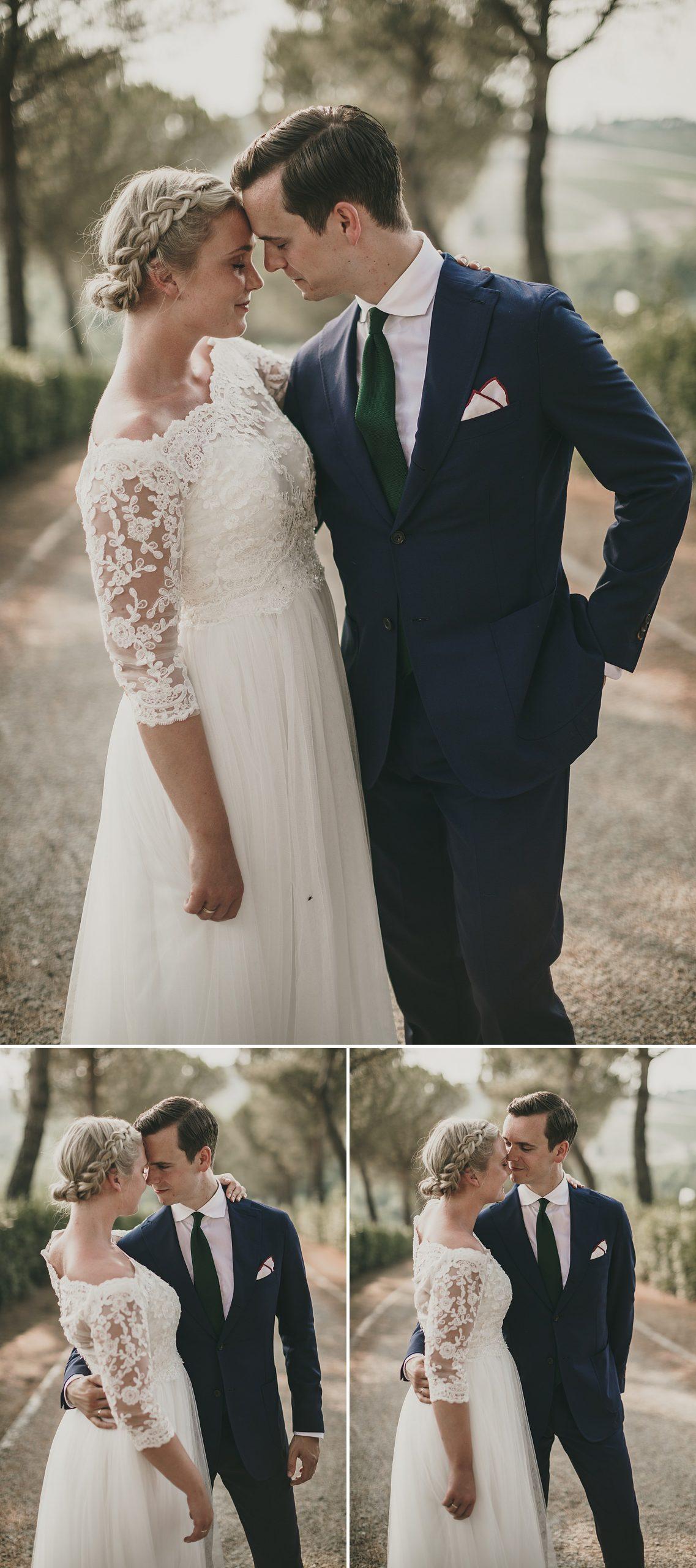 Coppia di sposi in un bellissimo viale alberato